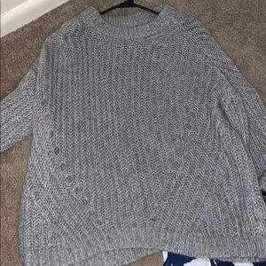 a gray sweater